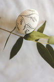 Easter egg decorated with branches Royalty Free Stock Photo