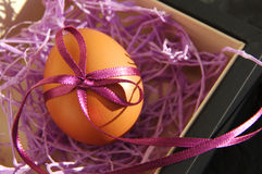 Easter egg are decorated bright with color tapes Royalty Free Stock Photography
