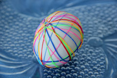 Easter egg. Decorated with colored rubber bands Stock Images