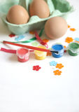 Easter Egg Decorating. Eggs in egg box ready to be decorated for easter celebration in paint and ribbons Stock Photos