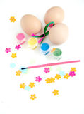 Easter Egg Decorating. Easter Egg decorationg fun for kids with paint and ribbons Royalty Free Stock Photo