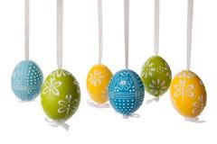 Easter egg decoration. Hanging over isolated white background Royalty Free Stock Image