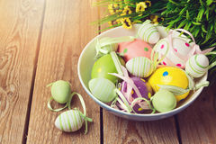 Easter egg decorations on wooden background Royalty Free Stock Photography