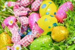 Easter egg deposited on the prairie grass. Colorful Easter egg deposited on the prairie grass Stock Photos