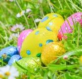 Easter egg deposited on the prairie grass. Colorful Easter egg deposited on the prairie grass Stock Photo