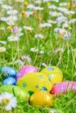 Easter egg deposited on the prairie grass. Colorful Easter egg deposited on the prairie grass Stock Image