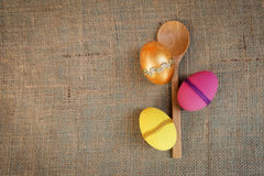 Easter egg design and wooden spoon over hessian texture Stock Images