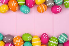 Easter egg double border against pink wood Stock Photos