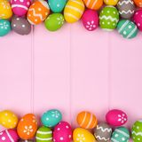 Easter egg double border against pink wood Stock Photo