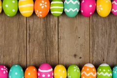 Easter egg double border against rustic wood Stock Image