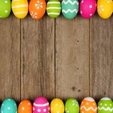 Easter egg double border against rustic wood Royalty Free Stock Photos