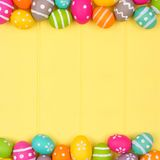 Easter egg double border against yellow wood Stock Image