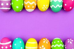 Easter egg double border over purple paper background Royalty Free Stock Images
