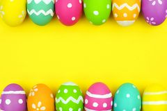 Easter egg double border over yellow paper background Stock Images