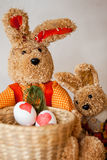 Easter Egg Dyeing. Two easter bunnys with dyed easter eggs Royalty Free Stock Image