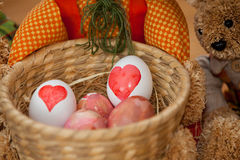 Easter Egg Dyeing. Two easter bunnys with dyed easter eggs Royalty Free Stock Photos