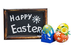 Easter egg and Easter greetings on a blackboard Stock Images