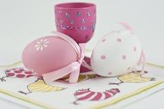 Easter egg and egg cup. Easter egg and eggcup placed on an napkin Royalty Free Stock Photo