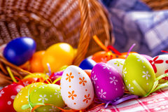 Easter Egg. S arranged with a tablecloth and basket weaving royalty free stock image