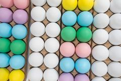 Easter egg festive background: different colored eggs on a table top stock photography