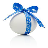 Easter egg with festive blue bow isolated Stock Images