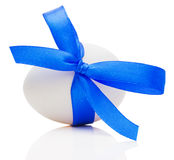 Easter egg with festive blue bow isolated on white background Royalty Free Stock Images