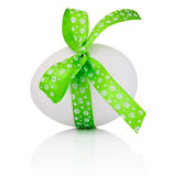 Easter egg with festive green bow isolated on white background Stock Photo