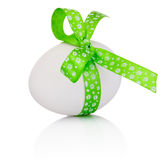 Easter egg with festive green bow  on white background Royalty Free Stock Photography