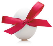Easter egg with festive red bow  on white background Stock Photo