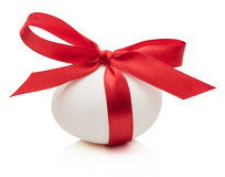 Easter egg with festive red bow  on white background Royalty Free Stock Photos