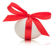 Easter egg with festive red bow  on white background Stock Photography