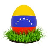 Easter egg with flag of Venezuela in the green grass, 3D rendering royalty free illustration