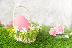 Easter egg in flower basket Royalty Free Stock Image