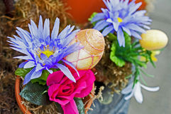 Easter egg in a flowerpot. Sparkling easter egg in a flowerpot, artificial Stock Images