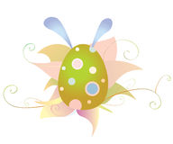 Easter egg and flowers with ears of a hare Royalty Free Stock Photos