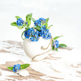 Easter egg flowers forget me not decoration. Easter egg and flowers forget me not. Holidays decoration Stock Images