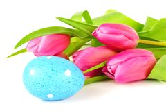 Easter egg and flowers Stock Photos