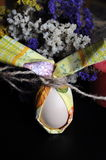 Easter egg with flowers. Egg wrapped in tissue paper Royalty Free Stock Image