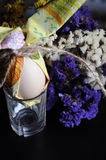 Easter egg with flowers. Egg wrapped in tissue paper Royalty Free Stock Photos