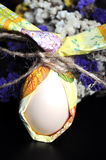 Easter egg with flowers. Egg wrapped in tissue paper Stock Photo