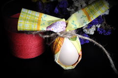 Easter egg with flowers. Egg wrapped in tissue paper Stock Photography