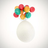 Easter egg flying on balloons Royalty Free Stock Photography