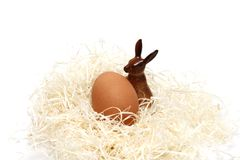 Easter egg food and ritual symbol. Easter eggs in Christianity symbol of the coffin and the resurrection of one egg o in a nest of wood shavings stock photography