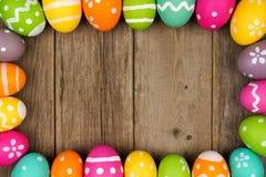 Easter egg frame against rustic wood Stock Image