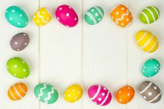 Easter egg frame against white wood Royalty Free Stock Photography
