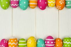 Easter egg frame against white wood Royalty Free Stock Photos