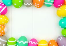 Easter egg frame over white wood Royalty Free Stock Photography