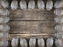 Easter egg frame on wooden rustic table stock photography