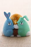 Easter egg in funny bunny and puppy eggcup Stock Photos
