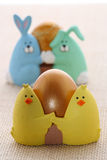 Easter egg in funny chick eggcup Royalty Free Stock Photography